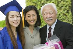 Graduate with mother and grandfather outside portrait Stock Photos