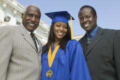 Female Graduate With Father And Brother Stock Photos