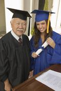 Female Graduate With Dean Smiling - stock photo