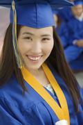 Young Female Graduate Smiling Stock Photos