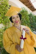 Female Graduating Student In An Academic Gown - stock photo