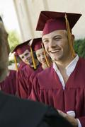 Stock Photo of Graduates Collecting Certificate From Dean