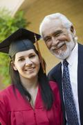 Young Female Graduate With Grandfather Stock Photos