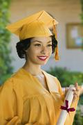 Young Female Graduate Holding Certificate - stock photo