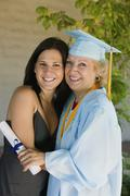 Happy Female Graduate With Granddaughter Stock Photos