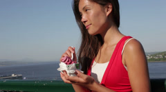 Woman eating Ice cream in Quebec City Stock Footage