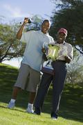 African American Men Holding Trophy Stock Photos