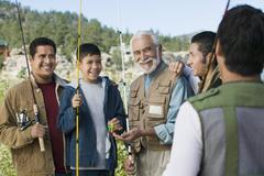 Hispanic Family On Fishing Trip Stock Photos