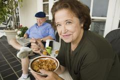 Senior Woman Having A Bowl Of Cereals - stock photo