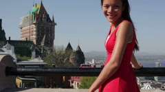 Woman tourist in Quebec City by Chateau Frontenac Stock Footage