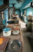 interior of old railway wagon kitchen - stock photo