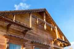 Detail of wooden roof gable on blue sky Stock Photos