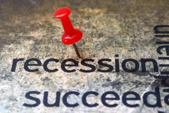 push pin on recession text - stock photo