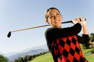 Stock Photo of Happy Young Woman Playing Golf