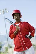 African American Woman Holding Baseball Bat Stock Photos