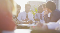 Cheerful business team in open air meeting with views of the city - stock footage