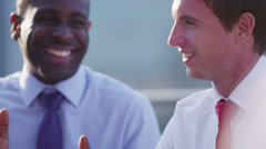 Happy business group chat and laugh together on outdoor city roof terrace - stock footage