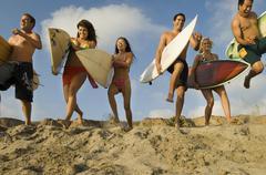 Friends With Surfboards Running On Sandy Beach Kuvituskuvat