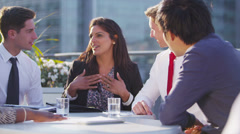 Happy business group chat and laugh together on outdoor city roof terrace Stock Footage
