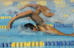 Participants In Swimming Race - stock photo