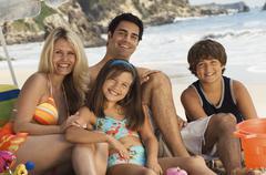 Happy Family At The Beach Stock Photos