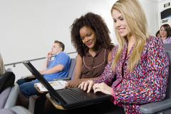 Stock Photo of Women Working On Laptop In Lecture Room