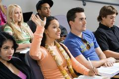 Student Raising Hand During Class Lecture Stock Photos