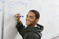 Student Solving Algebra Equation On Whiteboard Stock Photos