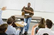 Stock Photo of College Students And Professor In Classroom