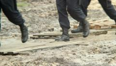 Military forces boots step over dirt, rescue emergency situation Stock Footage