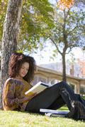 Woman Reading Book In College Campus - stock photo