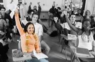 Stock Photo of Cheerful College Students In Classroom
