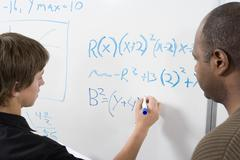 Young Student Doing Math Sums - stock photo