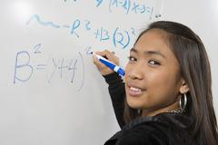 Asian Student Solving Problem - stock photo