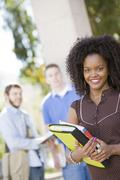 Smiling Female Student On College Campus Stock Photos