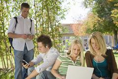 College Student Using Technologies On Campus Stock Photos