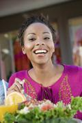 Stock Photo of Happy Woman Having Salad At Cafe