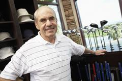 Happy Senior Man In Golf Store - stock photo