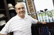 Stock Photo of Happy Senior Man In Golf Store