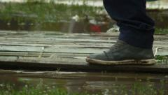 Natural catastrophe, legs passing by through water and dirt - stock footage