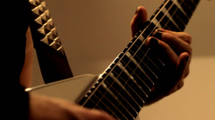 fingers playing electric guitar - stock footage