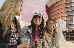 Women Enjoying Drinks Outside Shopping Mall Stock Photos