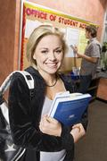 Stock Photo of College Student Holding Books