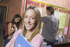 Stock Photo of Female Student Holding Folder