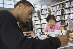 Students Studying In College Library - stock photo
