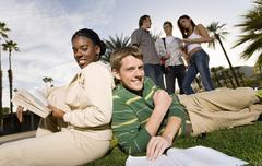 Friends In College Campus Stock Photos