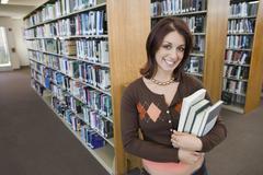 Stock Photo of Happy Female Holding Books