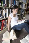 Stock Photo of Female Student Studying In Library