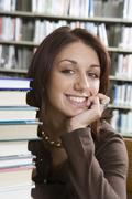 Cheerful Woman Sitting With Books - stock photo