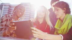 Cheerful group of businesswomen in a meeting outdoors in the city on a sunny day Stock Footage